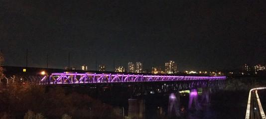 Edmonton High Level Bridge at night lit in purple